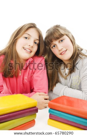 Two young teenage girls with pile colored book. Isolated. - stock photo