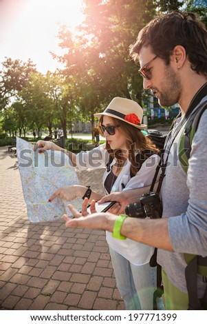 Two Young Tourists With Backpacks Sightseeing City - stock photo