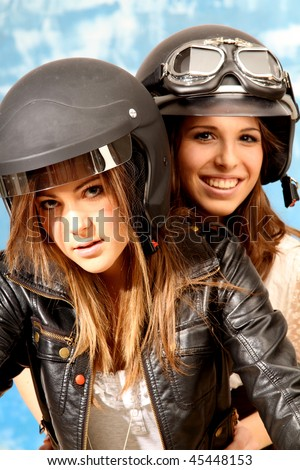 two young woman both wearing a helmet - stock photo