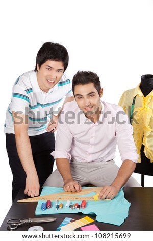 Two young woman dressmaker at work. - stock photo