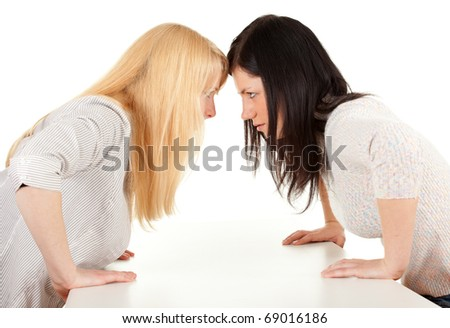 two young woman,  girlfriends quarre, white backgroundl - stock photo
