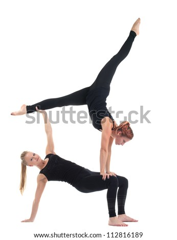 two young woman in black show acrobatic exercise - stock photo