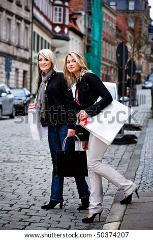 two young woman shopping in the city