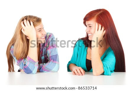 two young woman talking on the white background
