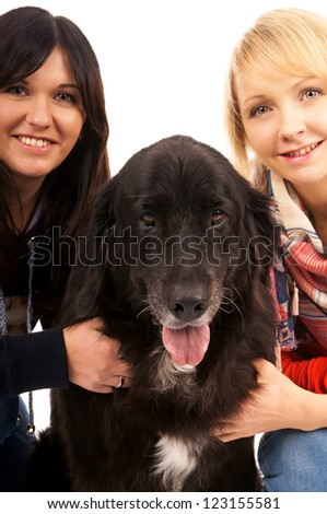 Two young woman with dog / Woman and Dog - stock photo