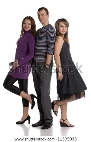 two young women and one man standing together isolated on white