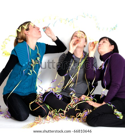 Two young women and one senior woman laughing at party. - stock photo