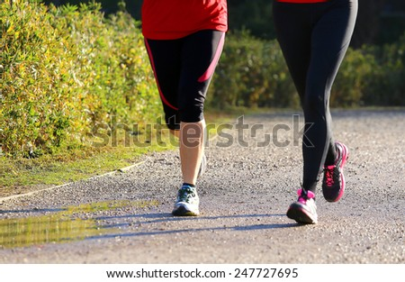 two young women during training run in outdoor Park - stock photo