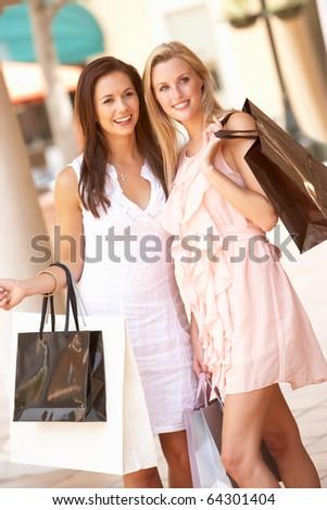 Two Young Women Enjoying Shopping Trip Together - stock photo