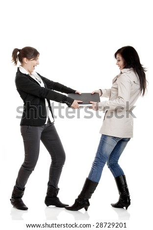 Two young women Fighting for a laptop, isolated on white