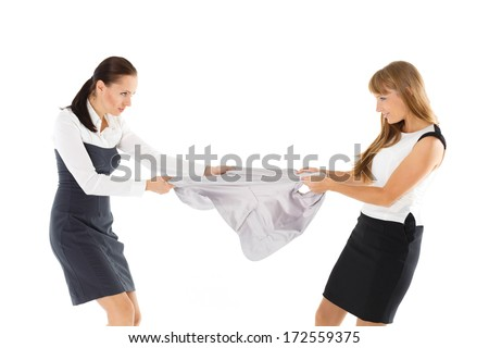 Two young women fighting for jacket on a white background. Sale. - stock photo