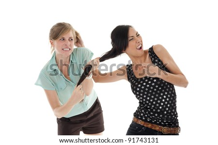 two young women having a fight over white background - stock photo