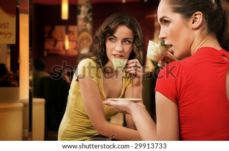 Two young women having lunch break together