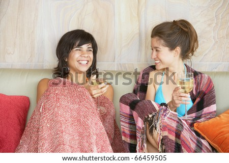 Two young women holding wineglasses - stock photo