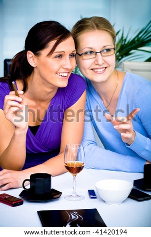 two young women in cafe - stock photo