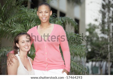 Two young women in the park - stock photo