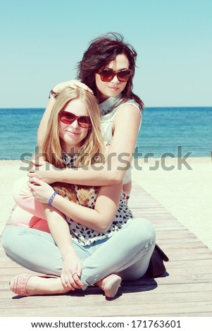 Two young women on a walk. Summer photo - stock photo