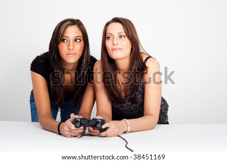 Two young women, playing video games