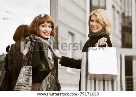 Two young women shopping - stock photo