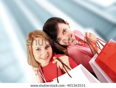 Two young women shopping at the mall - stock photo