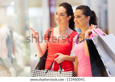 two young women shopping in mall - stock photo