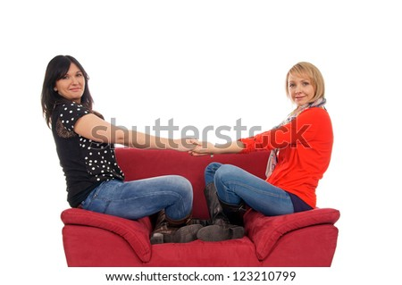 Two young women sitting on the couch / Two woman - stock photo