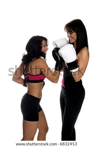 Two young women sparring and one connects with an uppercut. Some motion blur on the punching fighter
