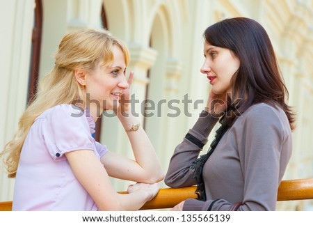 Two young women talking