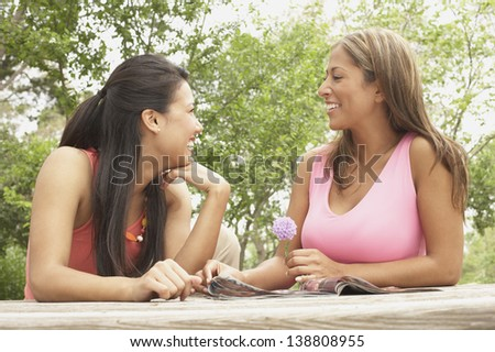Two young women together outside