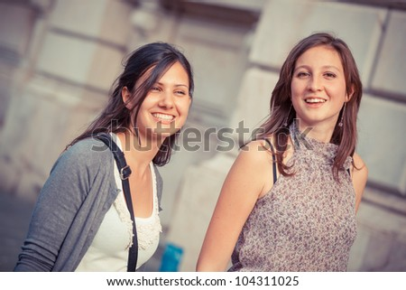 Two Young Women Walking in the City - stock photo