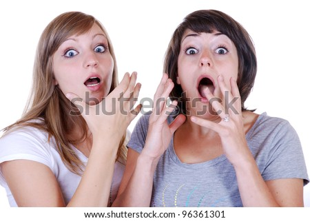 two young women with a shocked expression