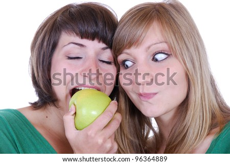 two young women with apples - stock photo