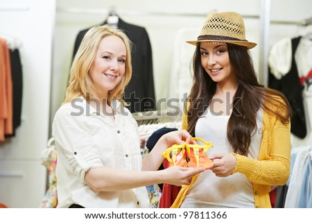 Two Young women with summer clothing during garments shopping at apparel store - stock photo