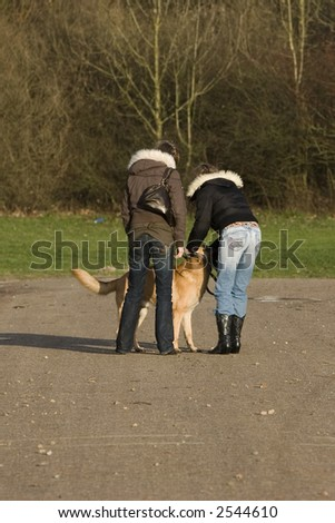 Two young women with their dog