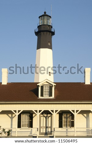 Tybee Island Lighthouse and Keepers Cottage Near Savannah GA in the Early Morning Light Vertical - stock photo