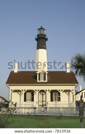 Tybee Island Lighthouse Keeper's Cottage Vertical At Sunrise With Copy Space - stock photo