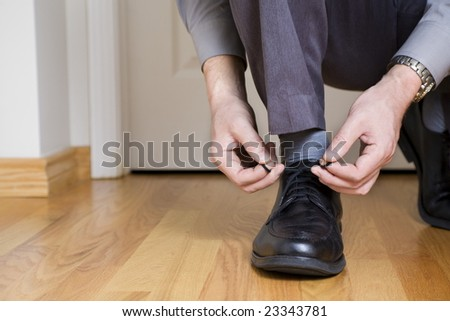 Tying shoes - stock photo