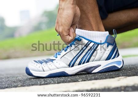 Tying sports shoe - stock photo