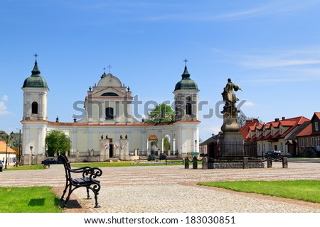 Tykocin, in Poland, Church of the Holy Trinity at the Town Square in and monument to hetman Stefan Czarniecki - stock photo