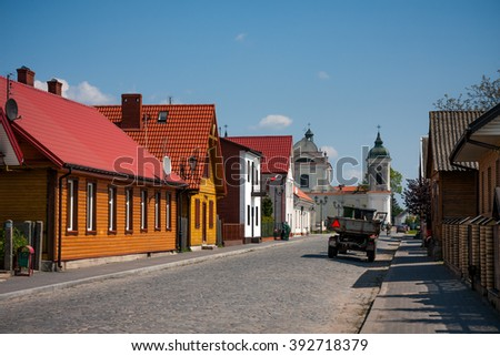 TYKOCIN, POLAND - MAY 10, 2010:  View on the Church and traditional town buildings. Architecture of Tykocin - stock photo