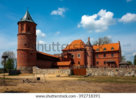 TYKOCIN TOWN, POLAND - MAY 10, 2010: 15th century Gothic castle in Tykocin during the reconstruction work - stock photo