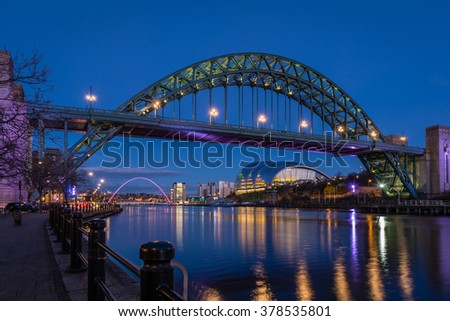 Tyne Bridge and quayside at night / The iconic bridges over the River Tyne between Newcastle and Gateshead have become famous and attract many visitors to the quayside