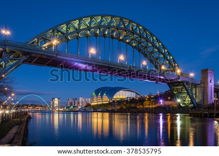 Tyne Bridge at night / The iconic bridges over the River Tyne between Newcastle and Gateshead have become famous and attract many visitors to the quayside - stock photo