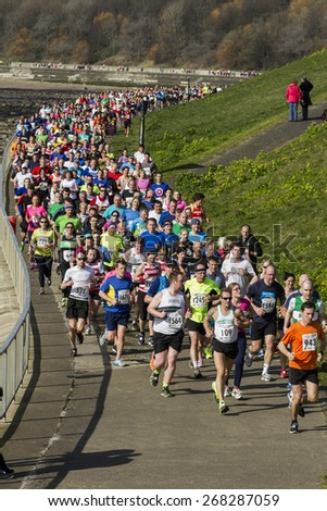 TYNEMOUTH, NORTH TYNESIDE, ENGLAND,UK, SUNDAY APRIL 5, 2015. Runners take part in North Tyneside Easter Sunday Fun Run along bank of River Tyne. Sunday April, 5, 2015, Tynemouth, England, UK.