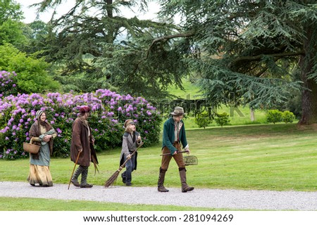 Tyntesfield, UK. 24th May 2015. Re-enactment actors walk around the grounds pretending to be Victorian peasants - stock photo