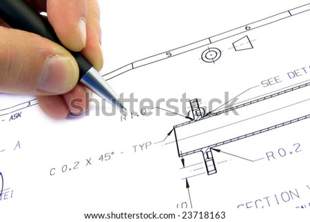 Typcial technical drawing on paper with a hand. - stock photo