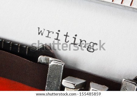 type spelling the word writing on a vintage typewriter, great concept for blogs, journalism, news, authors or the mass media - stock photo