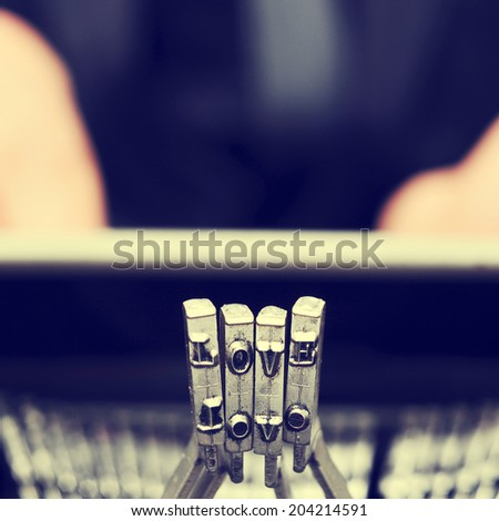 typebars of an old typwriter forming the word love, with a retro effect - stock photo