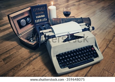 Typewriter and Cigar Box with Glass of Wine