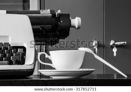 Typewriter and Coffee Cup; Black and white Photography.